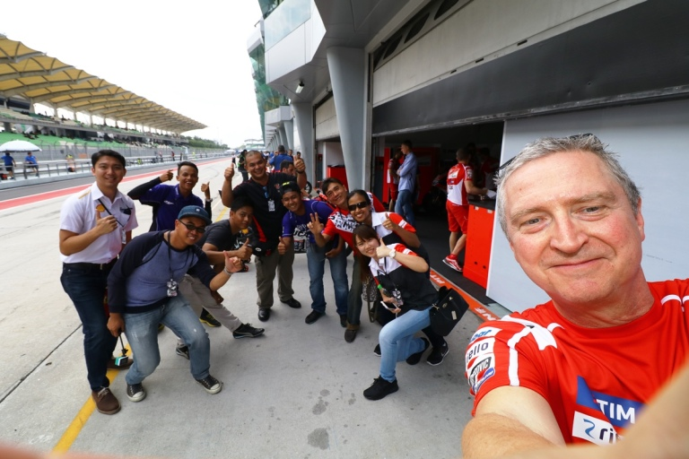 ducati-press-officer-julian-thomas-taking-a-wefie-for-shell-advances-guests-during-the-garage-tour