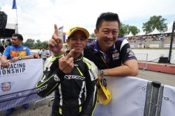 Akid (left) with team manager, Yong Yin Hoe