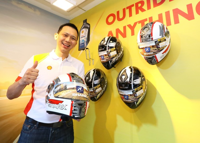 Shell Lubricants Mktg Mgr Alex Lim with Shark helmets to be won